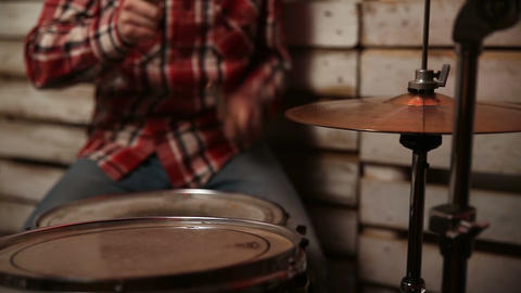 Expressive drummer playing at drums with drumstick Footage