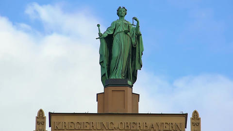 Beautiful statue of Lady Justice atop municipal building in Munich, Germany Footage