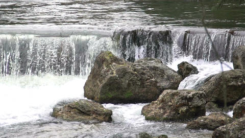 Waterfall water splashing on stones, time passing by, creative visual effect Footage
