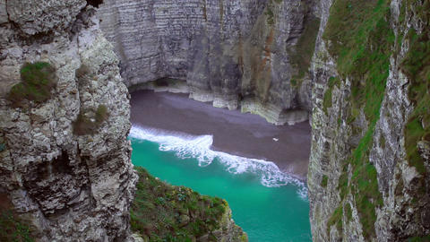 Empty private beach with azure water hidden between cliffs, paradise on earth Footage