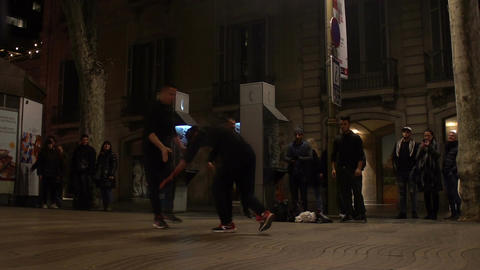 Street performance, boys showing acrobatic stunts to passersby, active lifestyle Footage