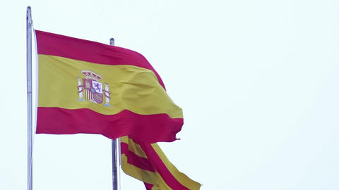 Spanish and Catalan flags waving in wind, freedom sign, nationality, patriotism Footage