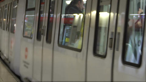 Subway train leaving platform, people walking in hall, public transportation Footage