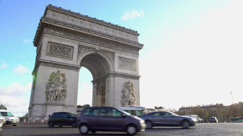 Many cars driving by Arc de Triomphe in sunlit Place Charles de Gaulle in Paris Footage