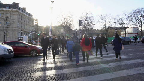 Many busy people crossing street in old European city, observing traffic rules Footage