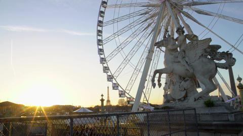 Sun going down in Paris, big wheel in Tuileries Garden, Eiffel Tower in distance Footage