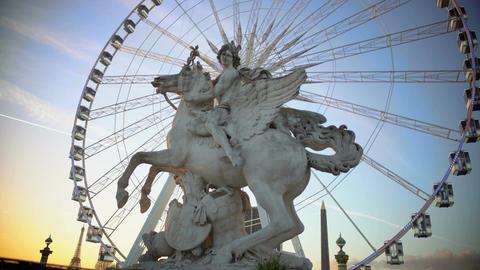 Mercury riding Pegasus statue and giant Ferris wheel in Tuileries Garden, Paris Footage