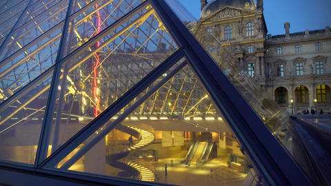 Tourists visiting Louvre art museum, view through glass pyramid, tour to Paris Footage