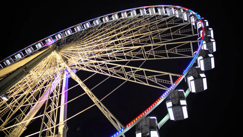 Huge observation wheel stops moving at night amusement park, entertainment Footage
