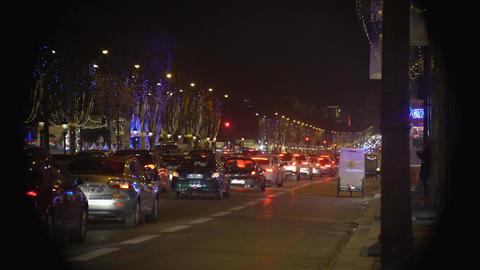 Traffic jam in night city, festive Christmas illumination decorating street Footage