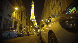 Defocused Eiffel Tower sparkling at the end of narrow street, night in Paris Footage