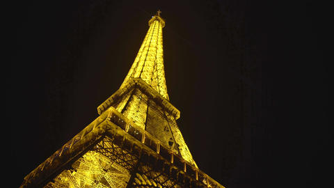 Majestic Eiffel Tower sparkling against black night sky background, Paris sight Footage