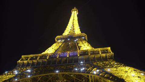 Eiffel Tower shimmering in darkness, worldwide known sight in Paris, France Footage