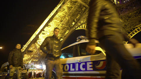 Group of young men walking by police car, emergency situation in night city Footage