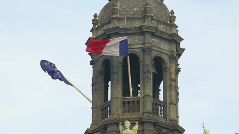 Flags of EU and France hanging on top of historical building, waving in the wind Footage
