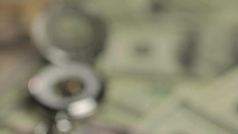 Luxury silver pocket watch on pile of US one hundred-dollar bills, time is money Footage