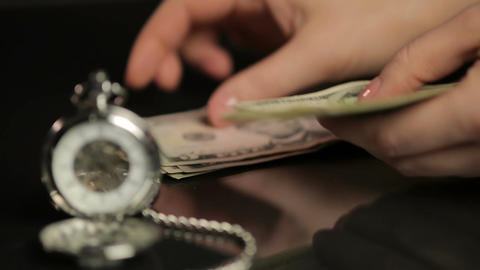 Hands counting paper money, mechanical watch showing time, budget planning Footage