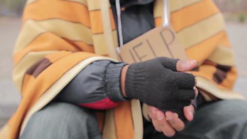Begging hand of homeless poor person asking for help, people donating money Live Action