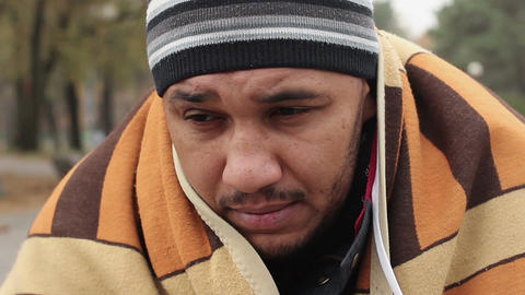 Miserable face of homeless male looking with hope at camera, begging. Poverty Footage