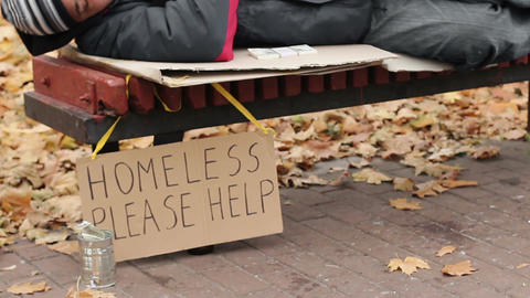 Charity, kind man leaving pack of money on bench while homeless male sleeps Footage
