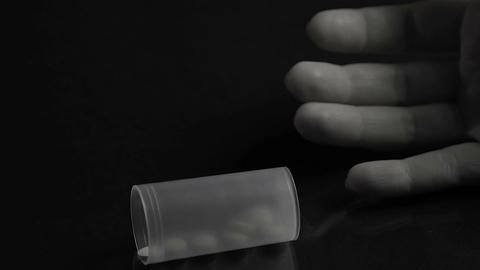 Hand of drug addict dying of overdosing, poisoned victim dropping pill container Footage