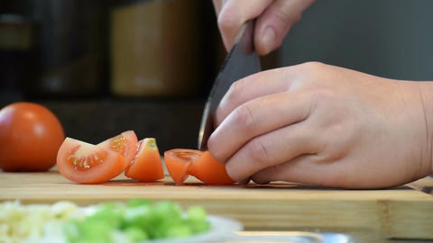 Closeup hands Roughly Chopping Tomatoes For Salad or Garnish Footage