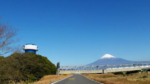 Fuji seen from the bank and the bullet train Footage