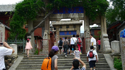 Tourists walking in mountain stone steps,vines wrapped... Stock Video Footage