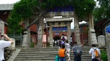 Tourists walking in mountain stone steps,vines wrapped around arch door,Chinese  Footage