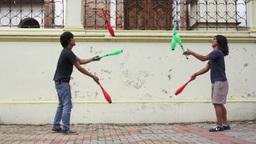 Two Street Jugglers Practicing Stock Video Footage