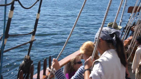 Crew of the Hawaiian Chieftain hauls sails 14014 1 Stock Video Footage