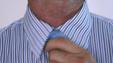 Businessman Fixing his Tie Stock Video Footage