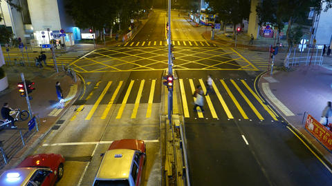 Pedestrian crossing against street intersection, top night view, time lapse Footage