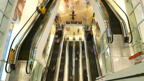 Several escalators from top, smooth people figures rush around, time lapse shot Footage