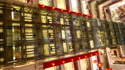 Moving elevators behind glass wall, large mall atrium, time lapse shot Footage