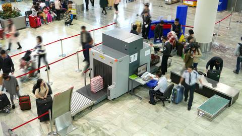 Passenger bag move through screening X-ray machine, time lapse shot Footage