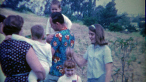 1954: Family converses while creepy redhead girl stares at camera Footage