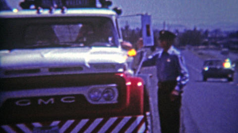 1964: Crashed cop car needs a tow from roadside ditch after police chase gone ho Footage