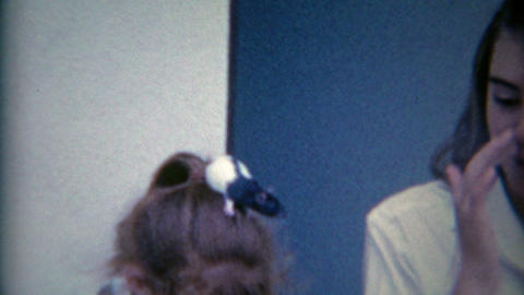 1954: Kids putting live rats on each others heads as a fun party gag, wacky rasc Footage