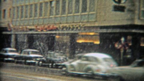 1966: Snowy slushy day in urban Rotterdam classic black taxi cars and traffic Footage