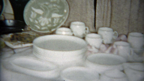 1964: Wedding gifts laid out on the table of kitchen and domestic home goods Footage