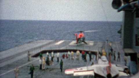 1956: Helicopter uploading and takeoff from USS Makassar Strait aircraft carrier Footage