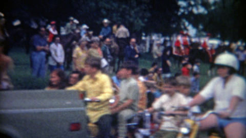 1962: Public parade featuring kids riding motorcycles and bikes Footage