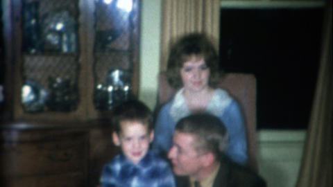 1966: Loud and brash dad smoking cigarette near boy and mother Footage