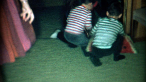 1966: Watermelon pinata breaks open and kids go crazy for candy Footage