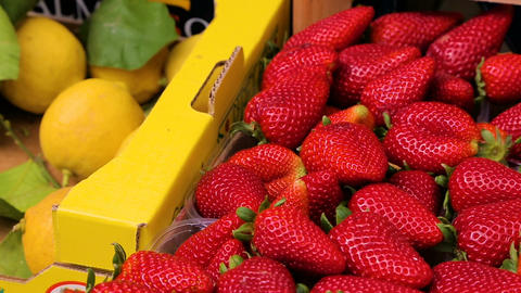 Fresh strawberries on the market close up Footage