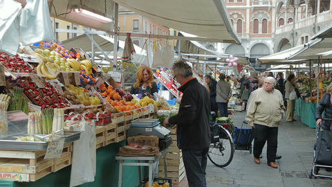 Retailing at Saturday market in Piazza delle Erbe Footage