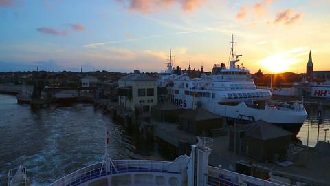 Ferry departs from the pier at sunset Footage