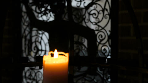 Burning candle in interere ancient castle Footage