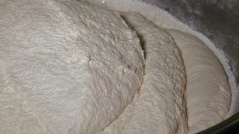 The dough is mixed in a large amount Footage